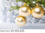Купить «Christmas decorations, balls on Christmas tree», фото № 29393625, снято 6 ноября 2018 г. (c) Юлия Бабкина / Фотобанк Лори