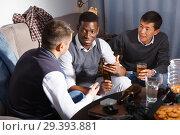 Купить «Cheerful men talking on sofa», фото № 29393881, снято 23 февраля 2018 г. (c) Яков Филимонов / Фотобанк Лори