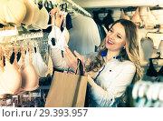 Купить «Pretty woman shopper choosing bras in shop», фото № 29393957, снято 20 марта 2017 г. (c) Яков Филимонов / Фотобанк Лори