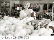 Купить «Mature woman buyer choosing colored yarn for knitting on sale», фото № 29396705, снято 20 декабря 2017 г. (c) Яков Филимонов / Фотобанк Лори