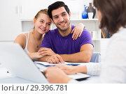 Купить «Young couple with real estate agent at home», фото № 29396781, снято 18 января 2020 г. (c) Яков Филимонов / Фотобанк Лори