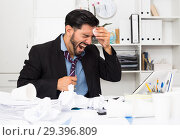 Купить «Adult businessman is sad because he is having issues at work place», фото № 29396809, снято 29 июля 2017 г. (c) Яков Филимонов / Фотобанк Лори