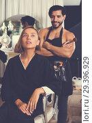 Купить «man makeup artist near client woman», фото № 29396929, снято 19 января 2019 г. (c) Яков Филимонов / Фотобанк Лори