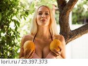 Купить «Beautiful large female breasts and two melons», фото № 29397373, снято 15 июня 2017 г. (c) katalinks / Фотобанк Лори
