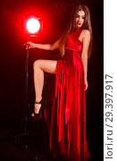 Купить «Young woman near the red lamp», фото № 29397917, снято 4 ноября 2018 г. (c) Art Konovalov / Фотобанк Лори