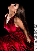 Купить «Young woman in a red dress», фото № 29397921, снято 4 ноября 2018 г. (c) Art Konovalov / Фотобанк Лори