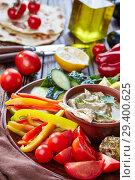 Купить «platter with veggiess and baba ganoush dip», фото № 29400625, снято 30 августа 2018 г. (c) Oksana Zh / Фотобанк Лори