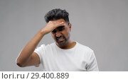 Купить «unhappy indian man suffering from headache», видеоролик № 29400889, снято 1 ноября 2018 г. (c) Syda Productions / Фотобанк Лори