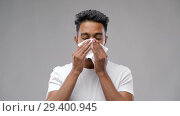 Купить «unhealthy indian man sneezing and blowing nose», видеоролик № 29400945, снято 1 ноября 2018 г. (c) Syda Productions / Фотобанк Лори