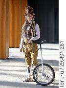 Купить «Pretty girl in a fantasy clothes with unicycle», фото № 29401281, снято 18 октября 2018 г. (c) Алексей Кузнецов / Фотобанк Лори