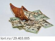 Купить «Cornucopia of U.S. paper currency and silver dollars», фото № 29403005, снято 23 марта 2019 г. (c) age Fotostock / Фотобанк Лори
