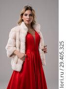 Купить «Blonde in red dress and fur jacket cropped shot», фото № 29405325, снято 31 октября 2018 г. (c) Гурьянов Андрей / Фотобанк Лори