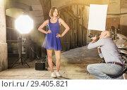 Купить «Professional photo shooting outdoors. Attractive female model po», фото № 29405821, снято 5 октября 2018 г. (c) Яков Филимонов / Фотобанк Лори