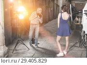 Купить «Photographer shooting female model on city street», фото № 29405829, снято 5 октября 2018 г. (c) Яков Филимонов / Фотобанк Лори