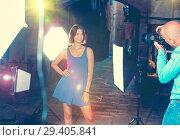 Купить «Professional photo shooting outdoors. Attractive female model po», фото № 29405841, снято 5 октября 2018 г. (c) Яков Филимонов / Фотобанк Лори