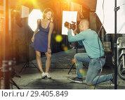 Купить «Professional photo shooting outdoors. Attractive female model po», фото № 29405849, снято 5 октября 2018 г. (c) Яков Филимонов / Фотобанк Лори