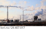 Купить «Industrial landscape. Panoramic view of the technological pipe and industrial infrastructure. Chemical production with red-white pipes and smoke is coming. Production buildings», видеоролик № 29407017, снято 29 октября 2018 г. (c) Mikhail Starodubov / Фотобанк Лори
