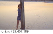 Купить «Calm girl enjoying sun, walking slowly through the water of a salt lake», видеоролик № 29407189, снято 3 ноября 2018 г. (c) Ирина Мойсеева / Фотобанк Лори