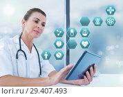 Купить «Female doctor holding tablet with medical interface hexagon icons», фото № 29407493, снято 15 декабря 2018 г. (c) Wavebreak Media / Фотобанк Лори