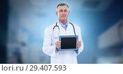 Купить «Male doctor holding tablet», фото № 29407593, снято 15 декабря 2018 г. (c) Wavebreak Media / Фотобанк Лори