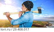 Купить «Man holding axe with dramatic landscape», фото № 29408017, снято 16 декабря 2018 г. (c) Wavebreak Media / Фотобанк Лори