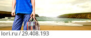 Купить «Travelling person with bag in front of sea landscape», фото № 29408193, снято 15 декабря 2018 г. (c) Wavebreak Media / Фотобанк Лори
