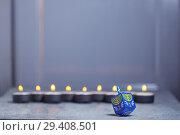 Купить «Defocused lights of Jewish holiday Hanukkah and spinning top», фото № 29408501, снято 10 ноября 2018 г. (c) Константин Сенявский / Фотобанк Лори