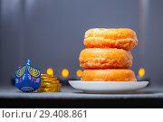 Купить «The Religious symbols of Jewish holiday Hanukkah», фото № 29408861, снято 10 ноября 2018 г. (c) Константин Сенявский / Фотобанк Лори