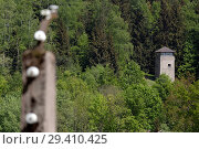 Купить «Bavaria, Germany - concentration camp memorial Flossenbuerg, view from the former camp fence to a watchtower», фото № 29410425, снято 5 мая 2018 г. (c) Caro Photoagency / Фотобанк Лори