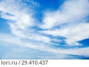 Купить «Cirrus clouds in blue sky at daytime», фото № 29410437, снято 30 октября 2018 г. (c) EugeneSergeev / Фотобанк Лори
