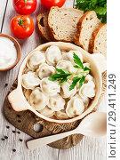 Купить «Dumplings in the pot», фото № 29411249, снято 19 февраля 2018 г. (c) Надежда Мишкова / Фотобанк Лори
