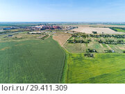Купить «European plain landscape, view from a great height. In the distance are visible factories», фото № 29411309, снято 14 августа 2018 г. (c) Андрей Радченко / Фотобанк Лори