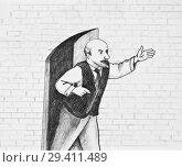 Купить «The man stands near the open door and points into the distance», иллюстрация № 29411489 (c) Олег Хархан / Фотобанк Лори