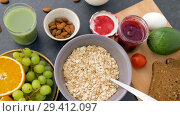 Купить «healthy breakfast of oatmeal and other food», видеоролик № 29412097, снято 2 ноября 2018 г. (c) Syda Productions / Фотобанк Лори