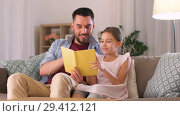 Купить «happy father and daughter reading book at home», видеоролик № 29412121, снято 6 ноября 2018 г. (c) Syda Productions / Фотобанк Лори