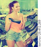 Купить «girl choosing pair of shoes in boutique», фото № 29412269, снято 15 сентября 2016 г. (c) Яков Филимонов / Фотобанк Лори