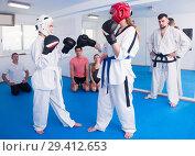 Купить «Two girls practice sparring at tekvando», фото № 29412653, снято 8 апреля 2017 г. (c) Яков Филимонов / Фотобанк Лори