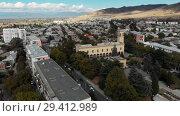 Купить «Gori city in Georgia Stalin's homeland 4K drone flight», видеоролик № 29412989, снято 6 ноября 2018 г. (c) Aleksejs Bergmanis / Фотобанк Лори