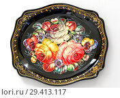 Купить «Zhostovo painting, old Russian folk handicraft of painting on metal trays, which still exists in village of Zhostovo. Tray with bright flowers», фото № 29413117, снято 12 ноября 2018 г. (c) Валерия Попова / Фотобанк Лори