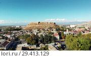 Купить «Fortress on the mountain Gori city in Georgia Stalin's homeland 4K drone flight», видеоролик № 29413129, снято 6 ноября 2018 г. (c) Aleksejs Bergmanis / Фотобанк Лори