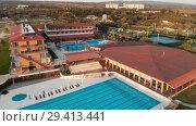 Купить «Hotel with Pool with blue water and golf course in Georgia», видеоролик № 29413441, снято 7 ноября 2018 г. (c) Aleksejs Bergmanis / Фотобанк Лори