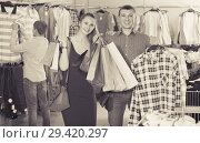 Купить «wife and husband with purchases in bags at apparel store», фото № 29420297, снято 13 апреля 2017 г. (c) Яков Филимонов / Фотобанк Лори