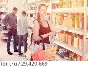 Купить «Woman choosing detergent at supermarket», фото № 29420669, снято 13 апреля 2017 г. (c) Яков Филимонов / Фотобанк Лори