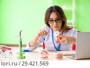 Купить «Woman dentist working on teeth implant», фото № 29421569, снято 11 июня 2018 г. (c) Elnur / Фотобанк Лори