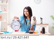 Купить «Young beautiful female doctor working in the clinic», фото № 29421641, снято 12 июля 2018 г. (c) Elnur / Фотобанк Лори