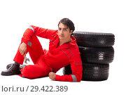 Купить «Young garage worker with tyre isolated on white», фото № 29422389, снято 21 июля 2018 г. (c) Elnur / Фотобанк Лори