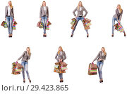 Купить «Beautiful woman with shopping bags isolated on white», фото № 29423865, снято 10 июля 2020 г. (c) Elnur / Фотобанк Лори