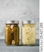 Glass jar with pickled cucumbers, copy space. Стоковое фото, фотограф Ольга Сергеева / Фотобанк Лори