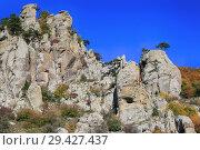 Купить «Beautiful view of the Demerdzhi Mountains in Crimea. Rocks and trees in the valley of ghosts», фото № 29427437, снято 12 октября 2018 г. (c) Яна Королёва / Фотобанк Лори