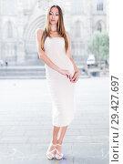 Купить «portrait of young female in sexually ivory midi gown standing in town», фото № 29427697, снято 24 июня 2017 г. (c) Яков Филимонов / Фотобанк Лори